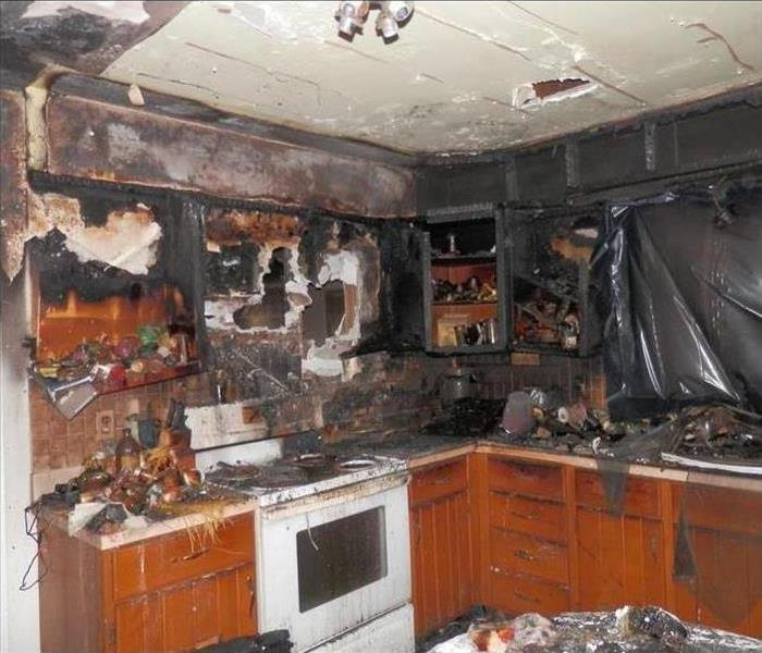 A kitchen completely burnt by fire