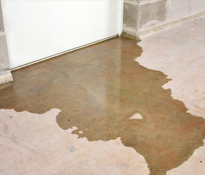 Water backup seeping under a door